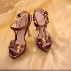 Gold Tone Sandals with a Platform